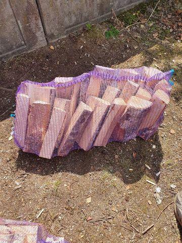 Дрова в сетках по 50 литров